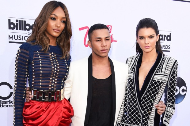 LAS VEGAS, NV - MAY 17: Model Jourdan Dunn, designer Olivier Rousteing and model Kendall Jenner, all wearing Balmain x H&M, attend the 2015 Billboard Music Awards at MGM Grand Garden Arena on May 17, 2015 in Las Vegas, Nevada. (Photo by Steve Granitz/WireImage)