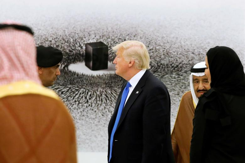 Saudi Arabia's King Salman shows Trump a depiction of the Kaaba in Mecca during a tour of pieces in the King's art collection at the Royal Court in Riyadh