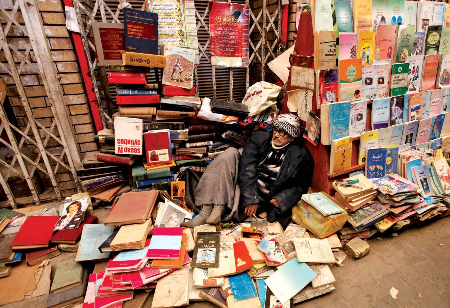 An elderly man sells books at Mutanabi Street in Baghdad