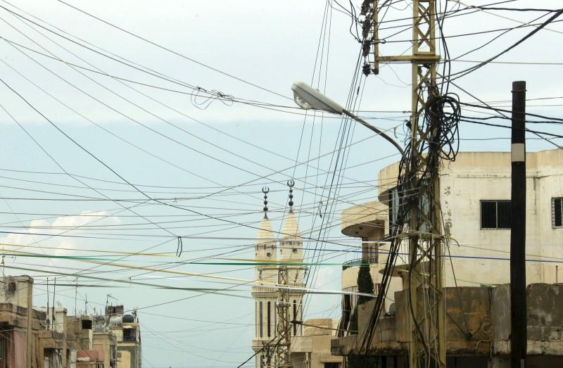 Power cables erected in a chaotic way are pictured at a residential area of Sibline village, in the Chouf area, Mount Lebanon