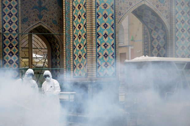 COVID-19 in Iran - medical team spray mosque
